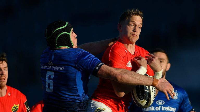 Mike Haley of Munster is tackled by Ryan Baird of Leinster