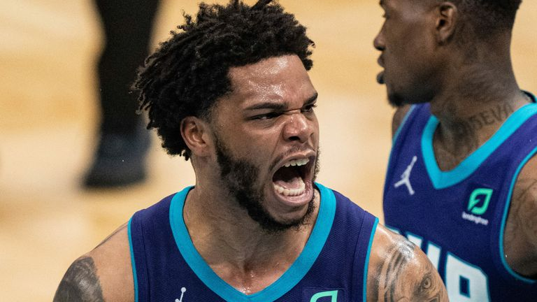 Miles Bridges roars in celebration after throwing down a huge dunk fo the Charlotte Hornets against the Atlanta Hawks