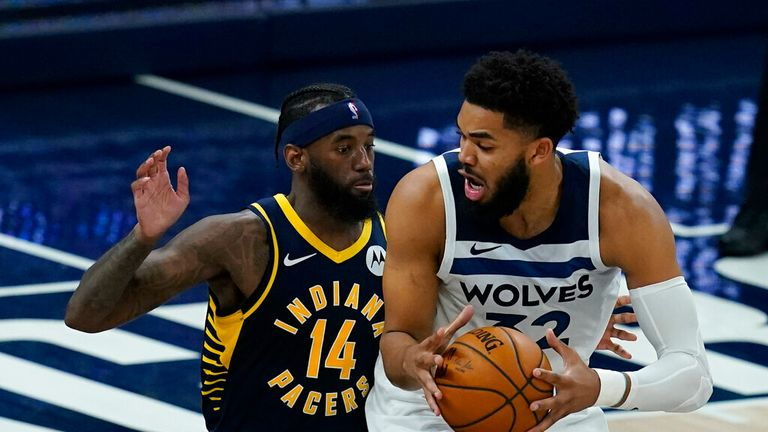 AP - Minnesota Timberwolves' Karl-Anthony Towns (32) is defended by Indiana Pacers' JaKarr Sampson (14)