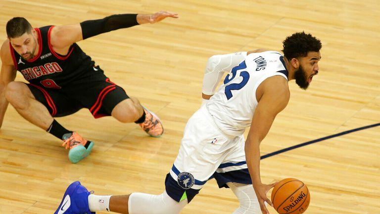 AP - Minnesota Timberwolves center Karl-Anthony Towns (32) leaves Chicago Bulls center Nikola Vucevic (9) on the floor