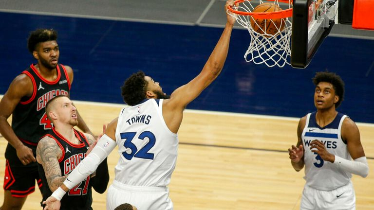 AP - Minnesota Timberwolves center Karl-Anthony Towns (32) dunks