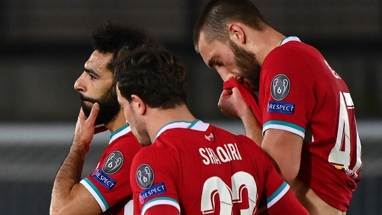 Liverpool's Egyptian midfielder Mohamed Salah, Liverpool's Swiss midfielder Xherdan Shaqiri and Liverpool's English defender Nathaniel Phillips react at the end of the UEFA Champions League first leg quarter-final football match between Real Madrid and Liverpool at the Alfredo di Stefano stadium in Valdebebas in the outskirts of Madrid on April 6, 2021.