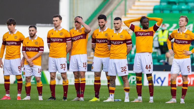 Motherwell's players look frustrated in the penalty shoot out
