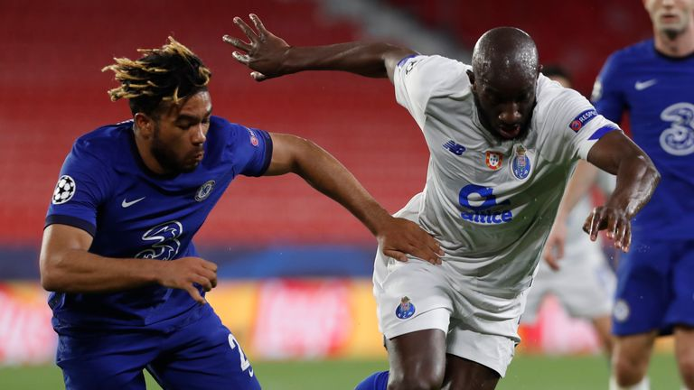 Porto's Moussa Marega, right, duels for the ball with Chelsea's Reece James during the Champions League quarter final second leg soccer match between Chelsea and Porto