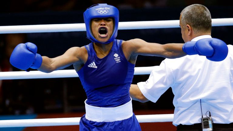 Great Britain's Natasha Jonas, reacts after her fight against the United States' Quanitta Underwood during a women's lightweight boxing match at the 2012 Summer Olympics, Sunday, Aug. 5, 2012, in London. (AP Photo/Patrick Semansky)
