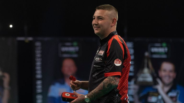 Nathan Aspinall tops the Premier League on leg difference from Dimitri Van den Bergh after the first phase ended in Milton Keynes (Lawrence Lustig/PDC)