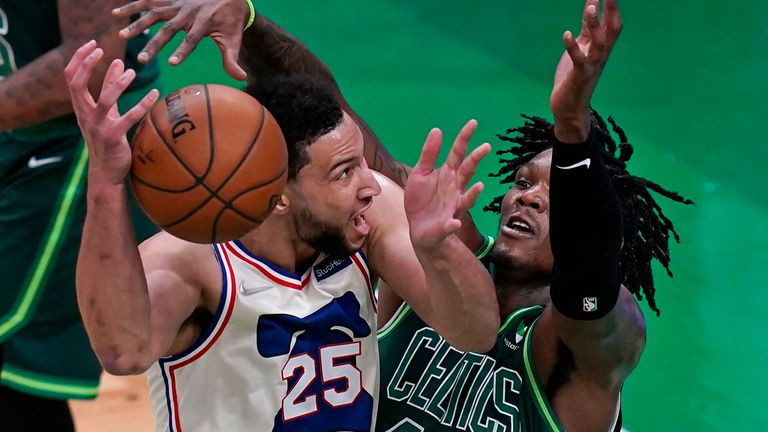 Boston Celtics center Robert Williams III, right, tries to block Philadelphia 76ers guard Ben Simmons, left, during the first half of an NBA basketball game, Tuesday, April 6, 2021, in Boston.