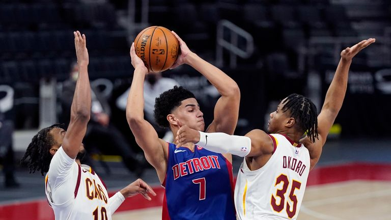 Detroit Pistons guard Killian Hayes (7) looks to pass as Cleveland Cavaliers guard Darius Garland (10) and forward Isaac Okoro (35) defend during the second half of an NBA basketball game, Monday, April 19, 2021, in Detroit. (AP Photo/Carlos Osorio)