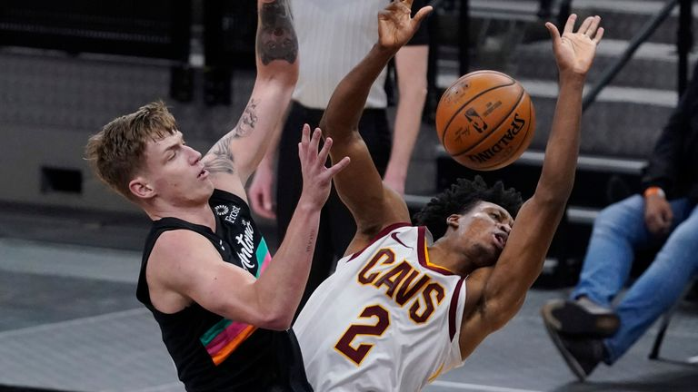 Cleveland Cavaliers guard Collin Sexton, right, is fouled b San Antonio Spurs forward Luka Samanic, left, during the second half of an NBA basketball game in San Antonio, Monday, April 5, 2021.