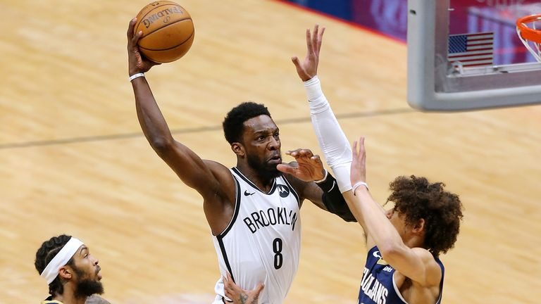 NEW ORLEANS, LOUISIANA - APRIL 20: Jeff Green #8 of the Brooklyn Nets dunks as Jaxson Hayes #10 of the New Orleans Pelicans and Brandon Ingram #14 defend during the first half at the Smoothie King Center on April 20, 2021 in New Orleans, Louisiana.