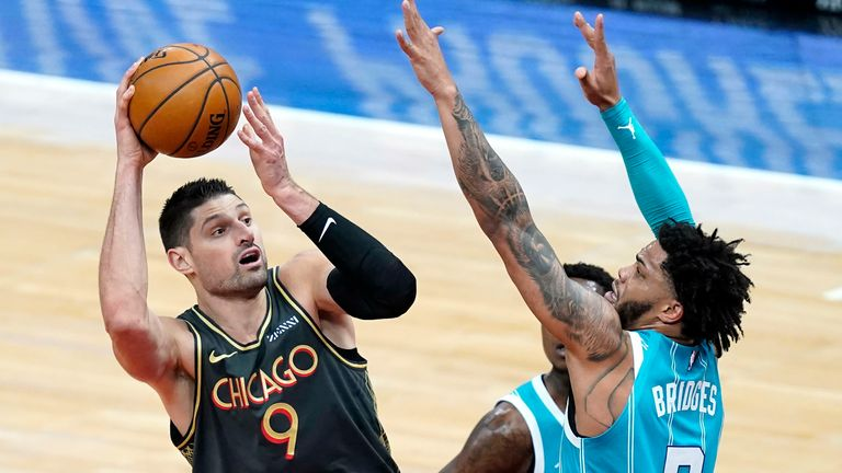 Chicago Bulls' Nikola Vucevic (9) shoots over Charlotte Hornets' Miles Bridges during the first half of an NBA basketball game Thursday, April 22, 2021, in Chicago.
