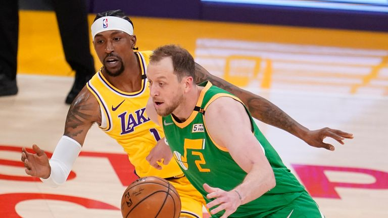 Utah Jazz guard Joe Ingles (2) dribbles past Los Angeles Lakers guard Kentavious Caldwell-Pope (1) during the first half of an NBA basketball game Monday, April 19, 2021, in Los Angeles. (AP Photo/Marcio Jose Sanchez)