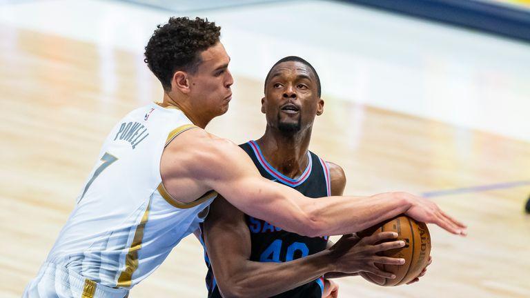 Sacramento Kings forward Harrison Barnes (40) battles Dallas Mavericks forward Dwight Powell (7) for space during the second half of an NBA basketball game, Sunday, April 18, 2021, in Dallas. (AP Photo/Brandon Wade)