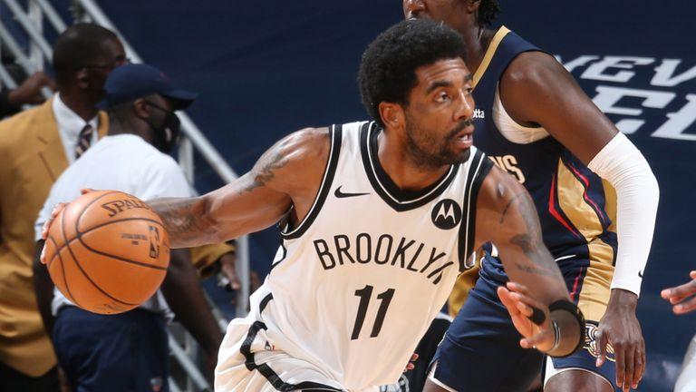 Kyrie Irving is swarmed by New Orleans Pelicans defenders