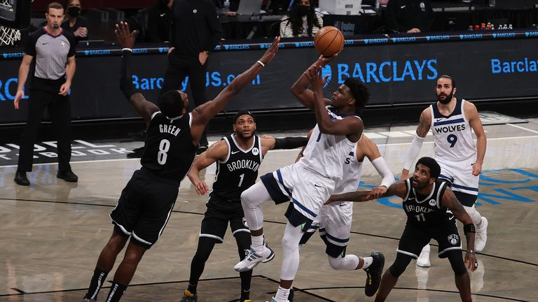 Anthony Edwards of the Minnesota Timberwolves shoots over Jeff Green of the Brooklyn Nets during their game at the Barclays Center on March 29, 2021 in New York City