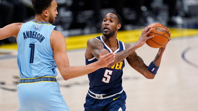 Denver Nuggets forward Will Barton, right, drives to the rim as Memphis Grizzlies forward Kyle Anderson defends in the second half of an NBA basketball game Monday, April 19, 2021, in Denver. (AP Photo/David Zalubowski)
