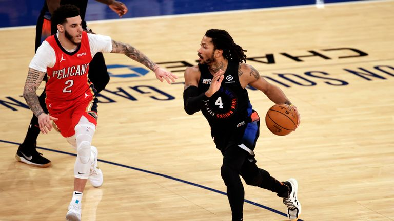 New York Knicks guard Derrick Rose (4) drives to the basket past New Orleans Pelicans guard Lonzo Ball (2) during the second half of an NBA basketball game Sunday, April 18, 2021, in New York. The Knicks won in overtime 122-112. (AP Photo/Adam Hunger, Pool)