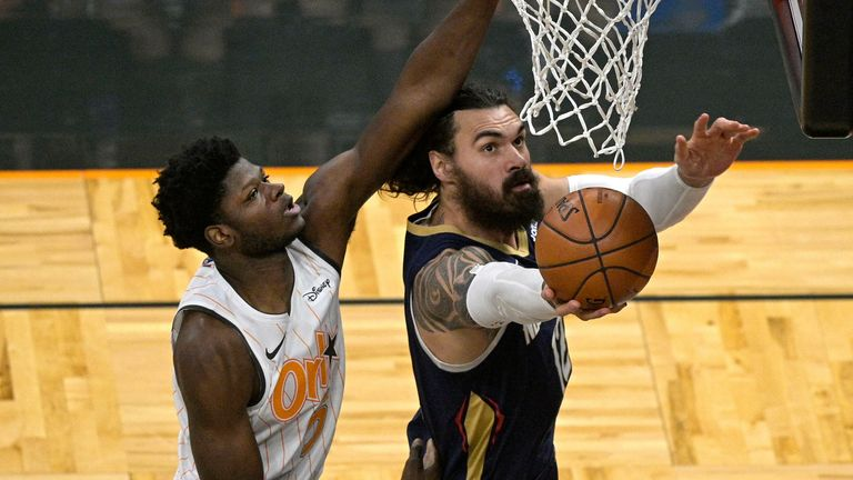 New Orleans Pelicans center Steven Adams (12) goes up for a shot in front of Orlando Magic center Mo Bamba (5) during the first half of an NBA basketball game, Thursday, April 22, 2021, in Orlando, Fla.