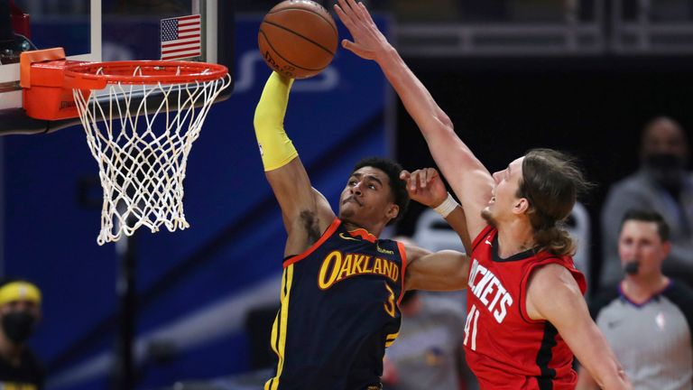 Golden State Warriors guard Jordan Poole, left, shoots next to Houston Rockets center Kelly Olynyk during the first half of an NBA basketball game in San Francisco, Saturday, April 10, 2021.