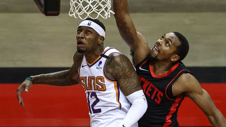 Houston Rockets forward Sterling Brown (right) shoots the ball against Phoenix Suns forward Torrey Craig (12) during the second quarter of an NBA basketball game in Houston, Monday, April 5, 2021.