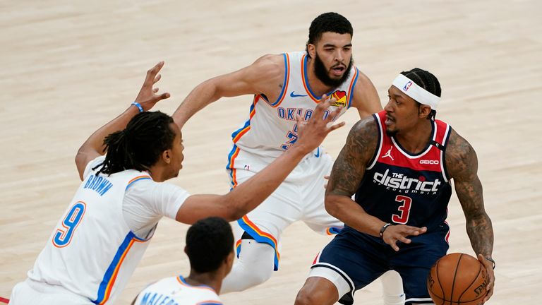 Washington Wizards guard Bradley Beal, right, protects the ball as he is pressured by Oklahoma City Thunder center Moses Brown (9), guard Theo Maledon (11) and forward Kenrich Williams in the first half of an NBA basketball game, Monday, April 19, 2021, in Washington. (AP Photo/Patrick Semansky)