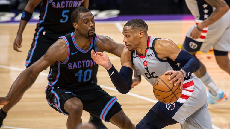 Washington Wizards guard Russell Westbrook (4) drives to the basket against Sacramento Kings forward Harrison Barnes (40) during the second quarter of an NBA basketball game in Sacramento, Calif., Wednesday, April 14, 2021. (AP Photo/Hector Amezcua)