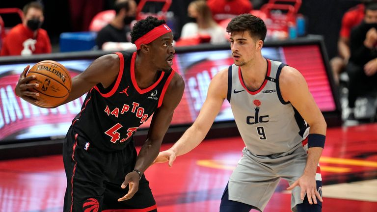 Toronto Raptors forward Pascal Siakam (43) looks to pass around Washington Wizards forward Deni Avdija (9) during the first half of an NBA basketball game Monday, April 5, 2021, in Tampa, Fla.