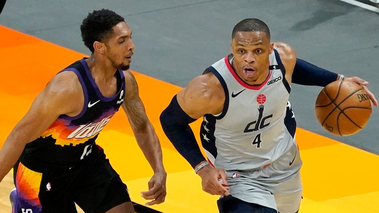 Washington Wizards guard Russell Westbrook (4) drives as Phoenix Suns guard Cameron Payne defends during the second half of an NBA basketball game, Saturday, April 10, 2021, in Phoenix.