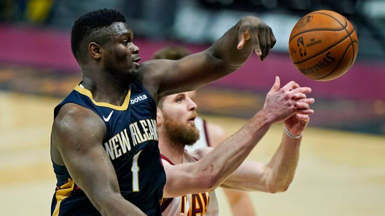 AP - New Orleans Pelicans' Zion Williamson, left, and Cleveland Cavaliers' Dean Wade battle for a rebound