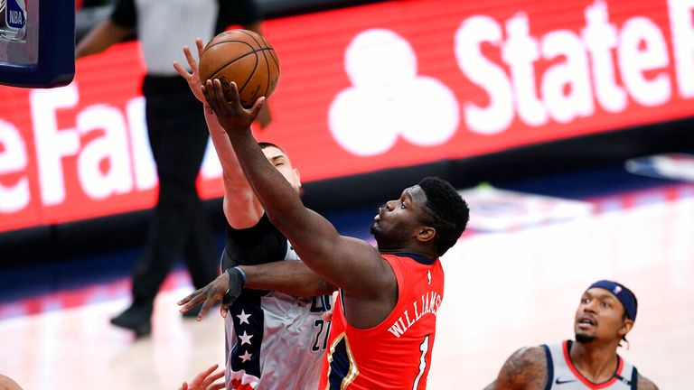 AP - New Orleans Pelicans forward Zion Williamson (1) goes to the basket against Washington Wizards center Alex Len (27) and guard Bradley Beal,