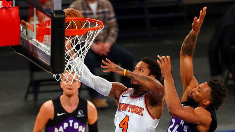 AP - New York Knicks' Derrick Rose (4) attempts to shoot as Toronto Raptors' Khem Birch (24) defends