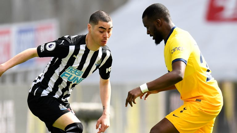 Newcastle's Miguel Almiron duels for the ball with Tottenham's Tanguy Ndombele