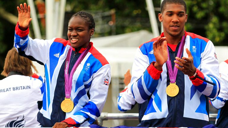 Nicola Adams and Anthony Joshua parade their gold medals
