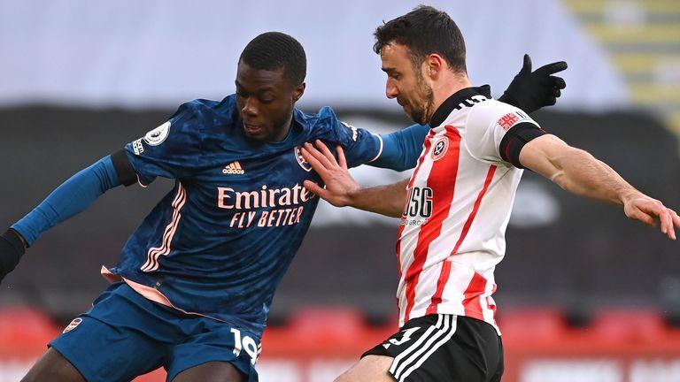 Arsenal's Nicolas Pepe battles for possession with Sheffield United's Enda Stevens
