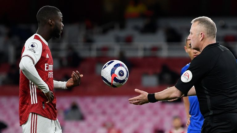 Nicolas Pepe hands the ball back to referee Jon Moss after the VAR call