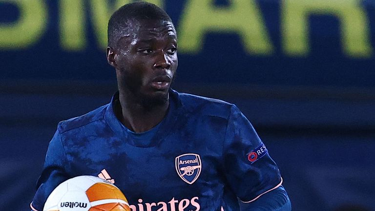 Nicolas Pepe retrieves the ball after scoring for Arsenal from the penalty spot