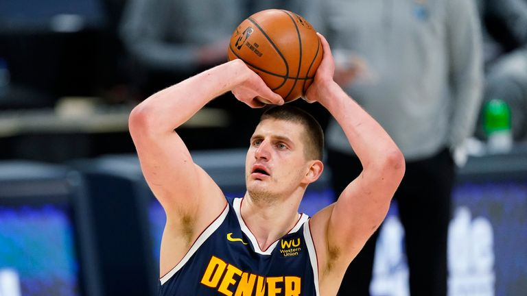 Nuggets' Nikola Jokic takes aim late in second overtime against the Grizzlies. (AP Photo/David Zalubowski)