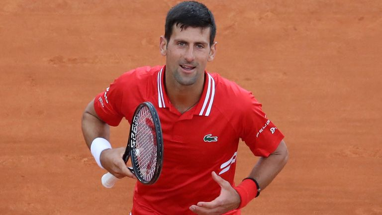 Novak Djokovic celebrates after winning his second round singles match against Italy's Jannik Sinner on day five of the Monte-Carlo ATP Masters Series tournament in Monaco on April 14, 2021. (Photo by Valery HACHE / AFP) (Photo by VALERY HACHE/AFP via Getty Images)