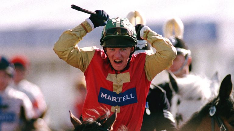 Paul Carbury celebrates winning on Bobbyjo in 1999