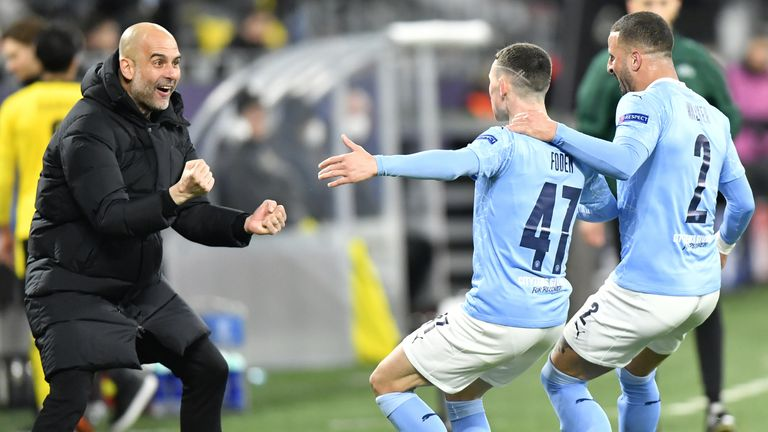 Pep Guardiola celebrates after Phil Foden's goal for Man City vs Borussia Dortmund