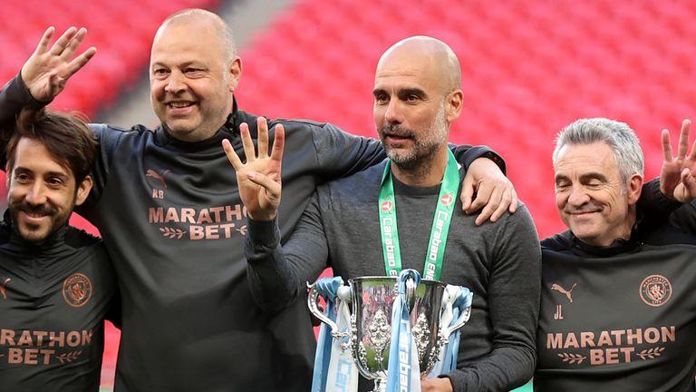 Pep Guardiola celebrates with coaching staff
