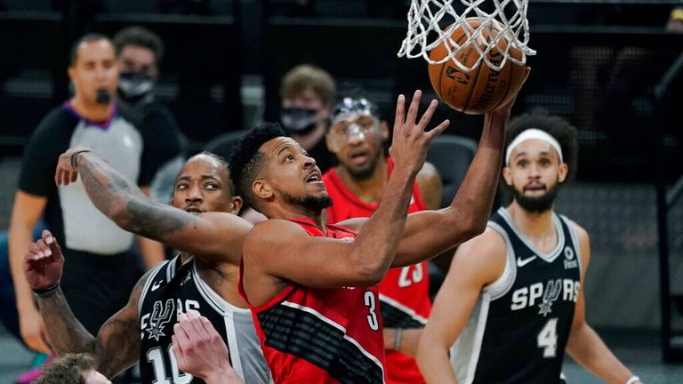 AP - Portland Trail Blazers guard CJ McCollum (3) drives to the basket past San Antonio Spurs forward DeMar DeRozan (10) during the second half