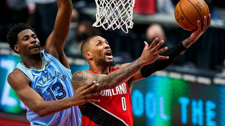 AP - Portland Trail Blazers guard Damian Lillard (0) shoots over Memphis Grizzlies forward Jaren Jackson Jr. (13)