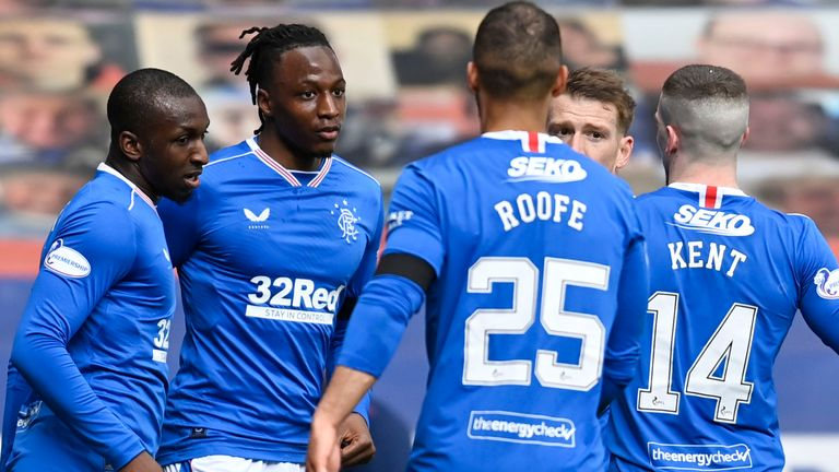 Rangers' Joe Aribo (centre) celebrates with team-mates after making it 1-0 against Hibernian at Ibrox