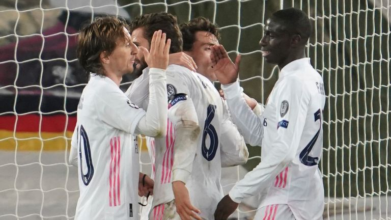 Real Madrid players celebrate at the end of the Champions League quarter-final second leg vs Liverpool