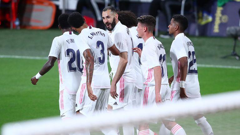 Karim Benzema scored twice as Real Madrid eased past Cadiz to return to the summit in La Liga