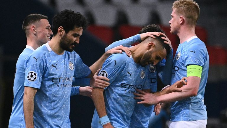 Man City players celebrate with Riyad Mahrez