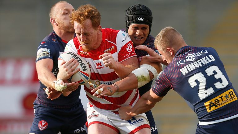 Leigh's Jordan Thompson takes on the St Helens defence