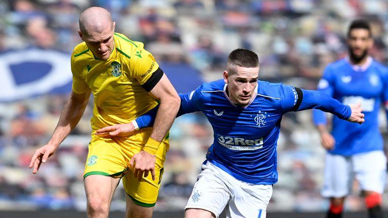 Rangers' Ryan Kent holds off Hibernian's Alex Gogic