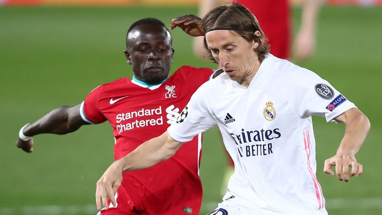 Sadio Mane and Luka Modric battle for possession during Real Madrid vs Liverpool in the Champions League